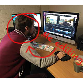 Jack at Computer Editing with Caption