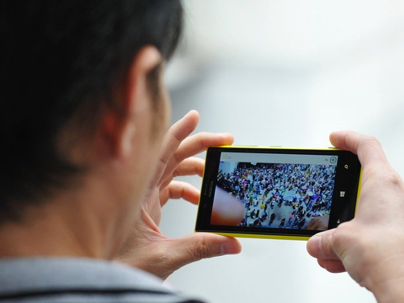 Man watching video streamed to his mobile