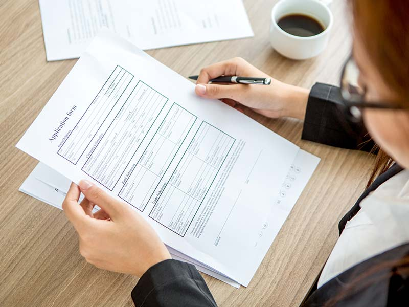 Employee with application form