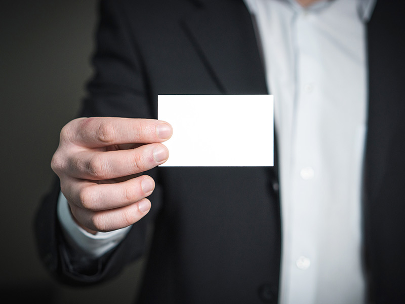 business card being shown by business man