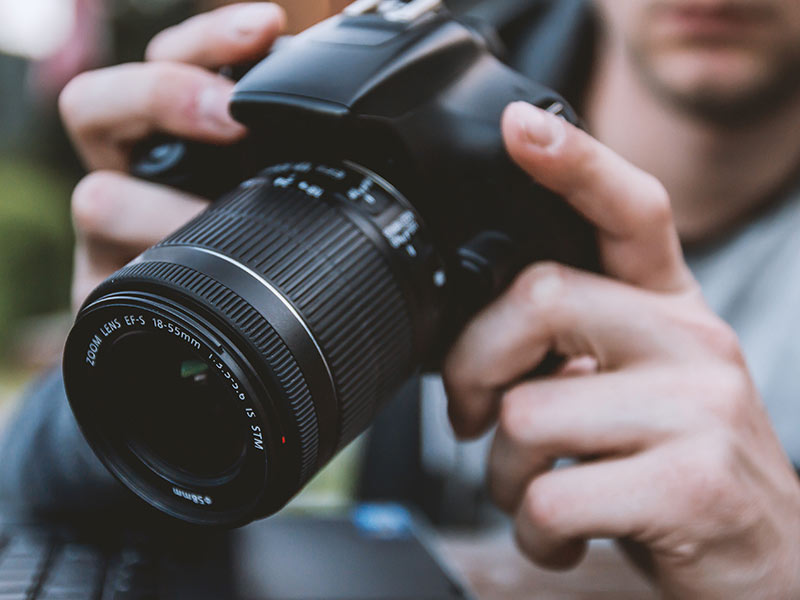 picture of man holding camera