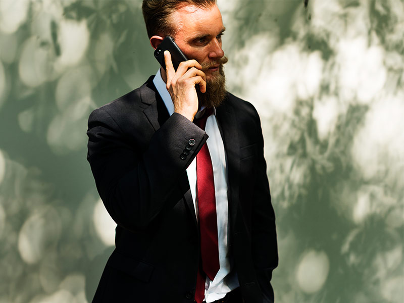 phone call made outside by man in suit
