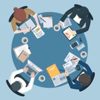 team having a business meeting around a desk