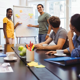 People in a Meeting Delegating tasks with a Whiteboard