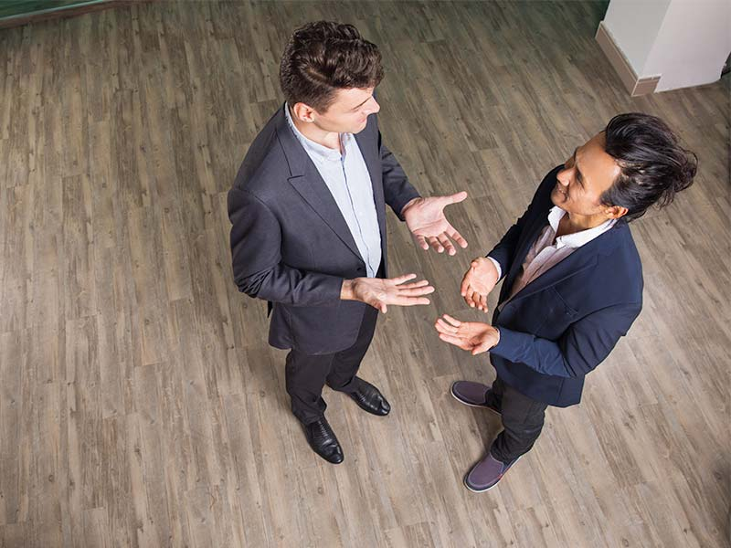 Two businessmen deep in conversation.