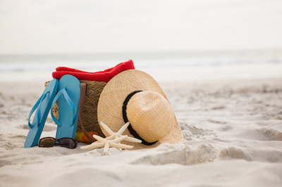 Beach hat and bag on holiday.