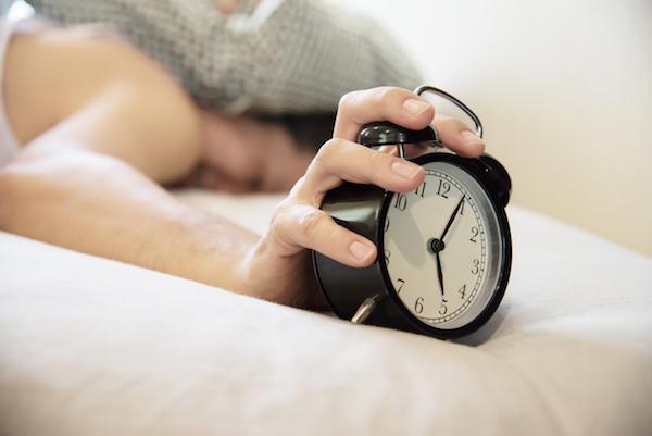 wake up at 5am, sleepy man with alarm clock